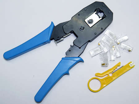 crimper:  Network cable crimper tool and  jack  isolated on white background