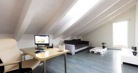 studio room with exposed beams and parquet and modern furniture