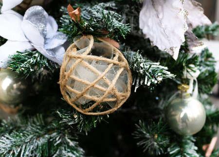 Christmas ball made with string and veil on fir Stock fotó
