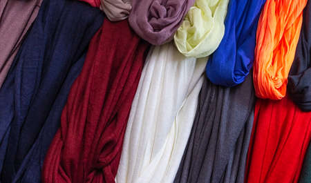 display of colored scarves in a market.