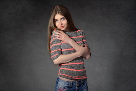bashfulness: Concept human emotions. Woman shows modesty or shyness against a dark background