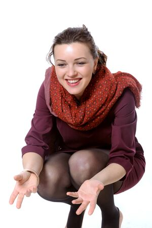 girl squatting: Woman with scarf squatted and laughing to himself invites
