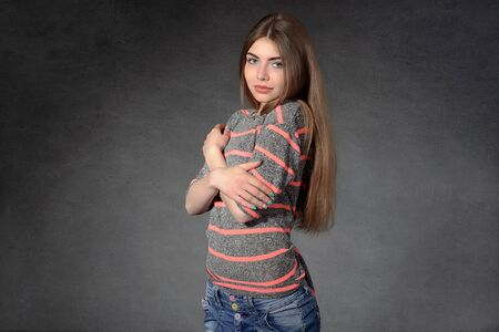 modesty: Concept human emotions. Girl shows modesty or shyness against a dark background Stock Photo