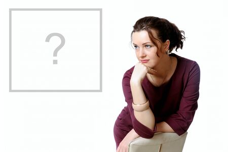 Girl in formal clothes ponder the question and looking to the side Stock Photo