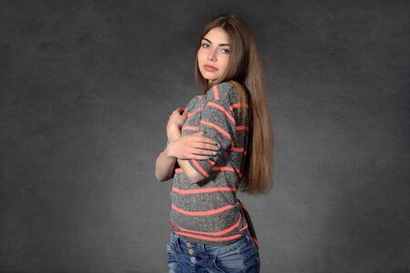 bashfulness: Concept human emotions. Girl shows modesty or timidity against a dark background
