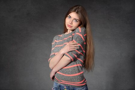 softness: Concept human emotions. Woman shows softness against a dark background