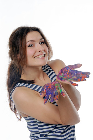 smeared hand: Woman shows smeared with paint hands isolated against background Stock Photo