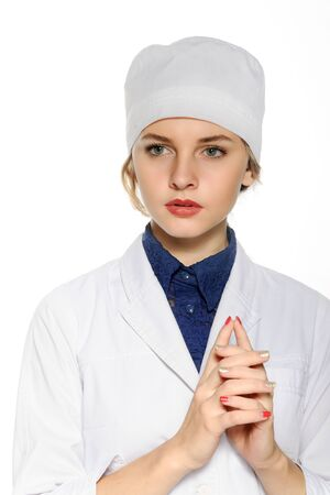 a white robe: Medical doctor in a white robe folded hands isolated against white background