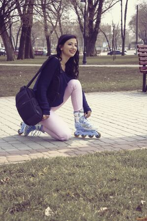 sexual activities: Girl rides on roller skates in the park. Digital photography in vintage style. Concept: lifestyle, sports, entertainment.