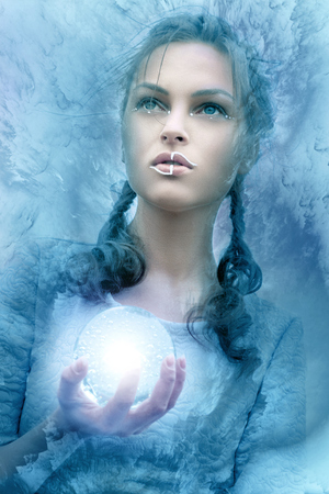 Girl holds a glass glowing sphere. Stylization photo fantasy styles.
