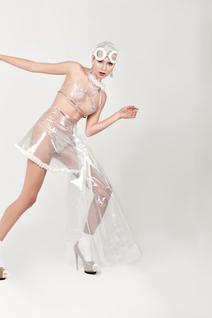 Girl tries to find a way out. She is dressed in an unnatural clothes made of transparent cellophane and preposterous glasses. The concept of the ambiguity of new materials to the environment.