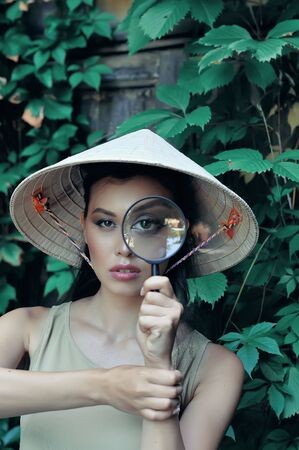 Girl with magnifying magnifying glass shows that nothing can be hidden from her