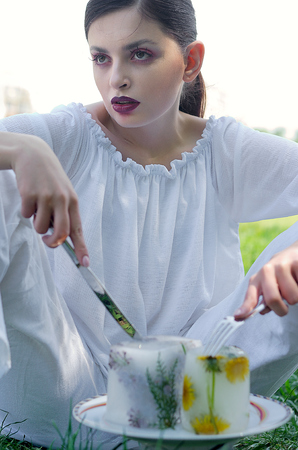 Fashion portrait of a girl who eats frozen artificial food Stock Photo