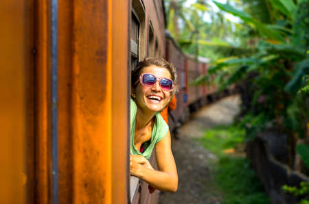 sri: Young woman traveling by train in Sri Lanka Stock Photo