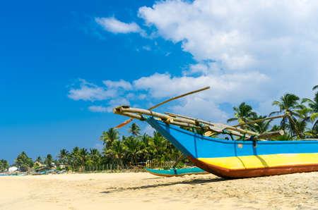 Traditional fisherman boat in Sri Lanka beach