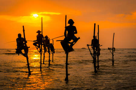 Silhouettes of the traditional fishermen at the sunset in Sri Lanka Stok Fotoğraf - 87252684