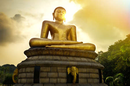 Buddha statue over scenic sunset sky in Colombo, Sri Lanka
