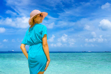 Young beautiful woman relaxing on a beach Stock Photo