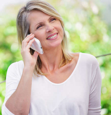 remoteness: beautiful smiling blond woman talking on the phone
