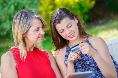 purchase: online purchase mother and daughter with tablet Stock Photo