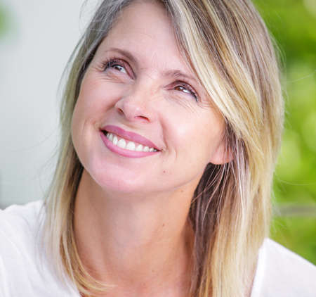 pretty blond woman of middle-aged smiling Stock Photo