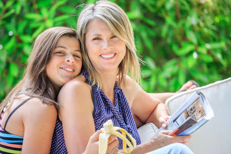 complicity: Complicity between mother and her daughter in a garden