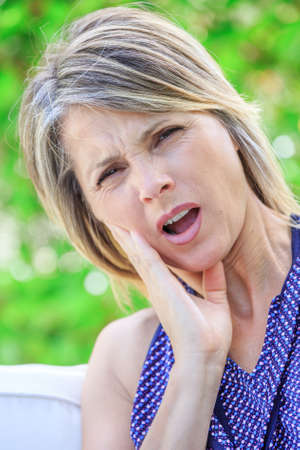 buccal: Woman suffering teeth strong pain