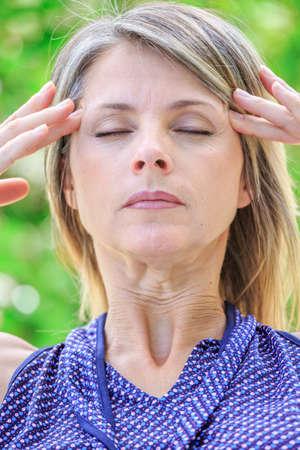 intense: woman with intense stress and painful headache Stock Photo