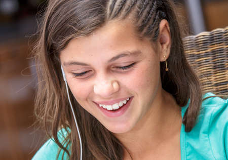 handsfree telephone: closeup of a pretty girl smiling with a headset Stock Photo