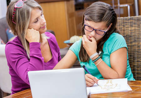 biology instruction: pretty student girl taking courses with beautiful blond teacher