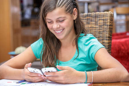 obsolescence: closeup of happy student synchronizing her new smartphone Stock Photo