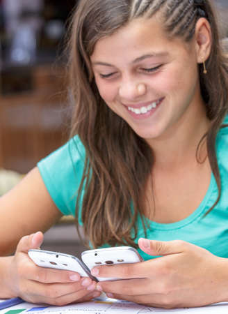 autodidact: closeup of happy student synchronizing her new smartphone Stock Photo
