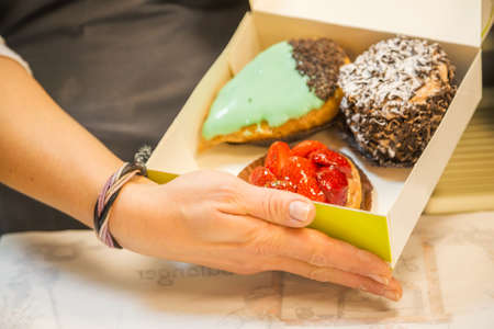 sinful: delicious pastries with cream in a box Stock Photo