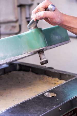 closeup of an industrial machine prepare a dough bread Standard-Bild