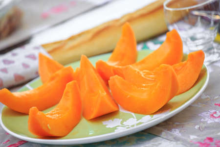 delicious Cantaloupe melon slices on the plate on table