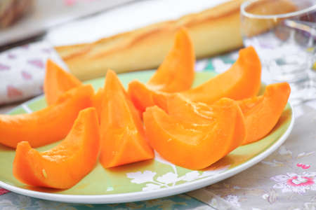Cantaloupe: delicious Cantaloupe melon slices on the plate on table