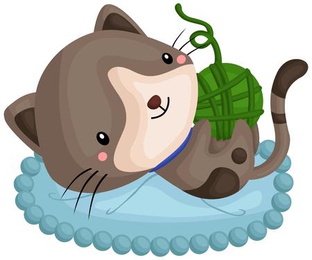 un gato gris jugando con su ovillo de lana