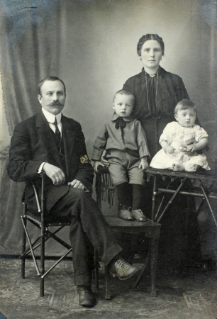 family history: RUSSIAN EMPIRE - CIRCA 1900 Vintage family portrait  Mother, father and children