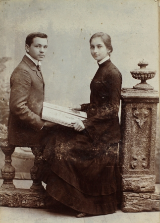 old black man: RUSSIAN EMPIRE - CIRCA 1910 Vintage photo shows young man and woman