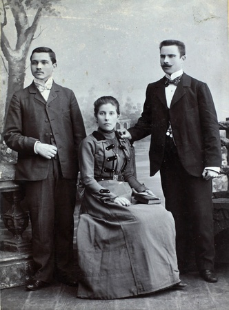 RUSSIAN EMPIRE - CIRCA 1910 Vintage photo shows three young friends wearing elegant clothing