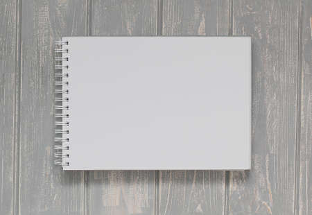 book concept: Note book on grey wooden desk. Top view. Stock Photo