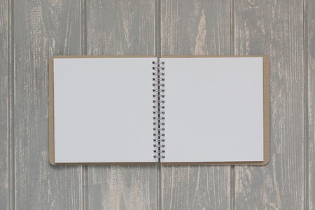 whitem: Note book on grey wooden desk. Top view. Stock Photo
