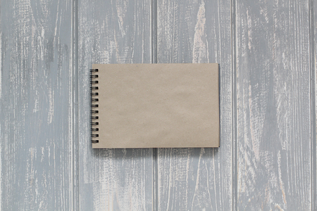 blank note: Note book on grey wooden desk. Top view. Stock Photo