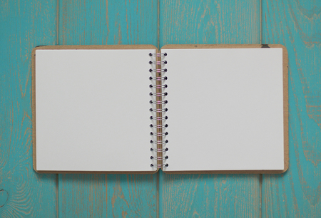 turquoise: Note book on blue wooden desk. Top view. Stock Photo