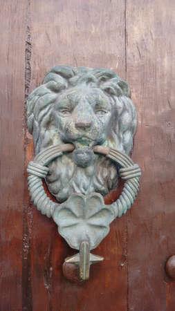 knocker: Door handle knocker or door knocker with lion image