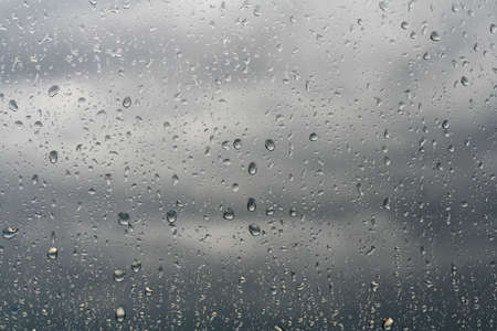 season: Rain drops on a window-pane. Stock Photo