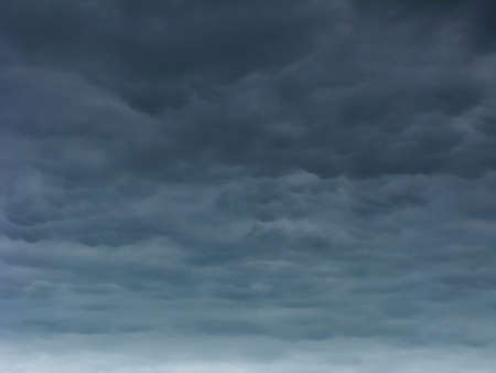 Stormy clouds on a dark blue sky