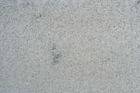 Sawn granite slab with raw, natural surface. Granite stone texture.