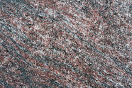 Dark, grained granite stone texture with polished surface