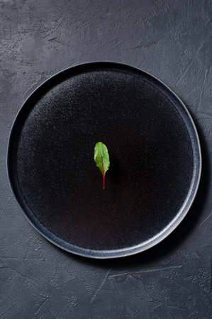 Mangold on a black plate, minimalism, concept. Dark background, top view, space for text
